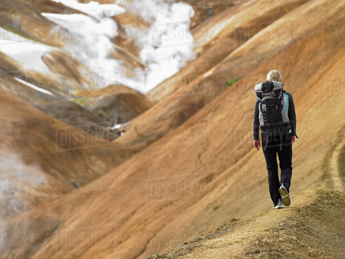 Young woman hiking along ridge in the Icelandic highlands Royalty-free stock photo