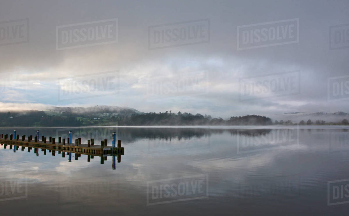 Pier at still lake in the British Lake District Royalty-free stock photo