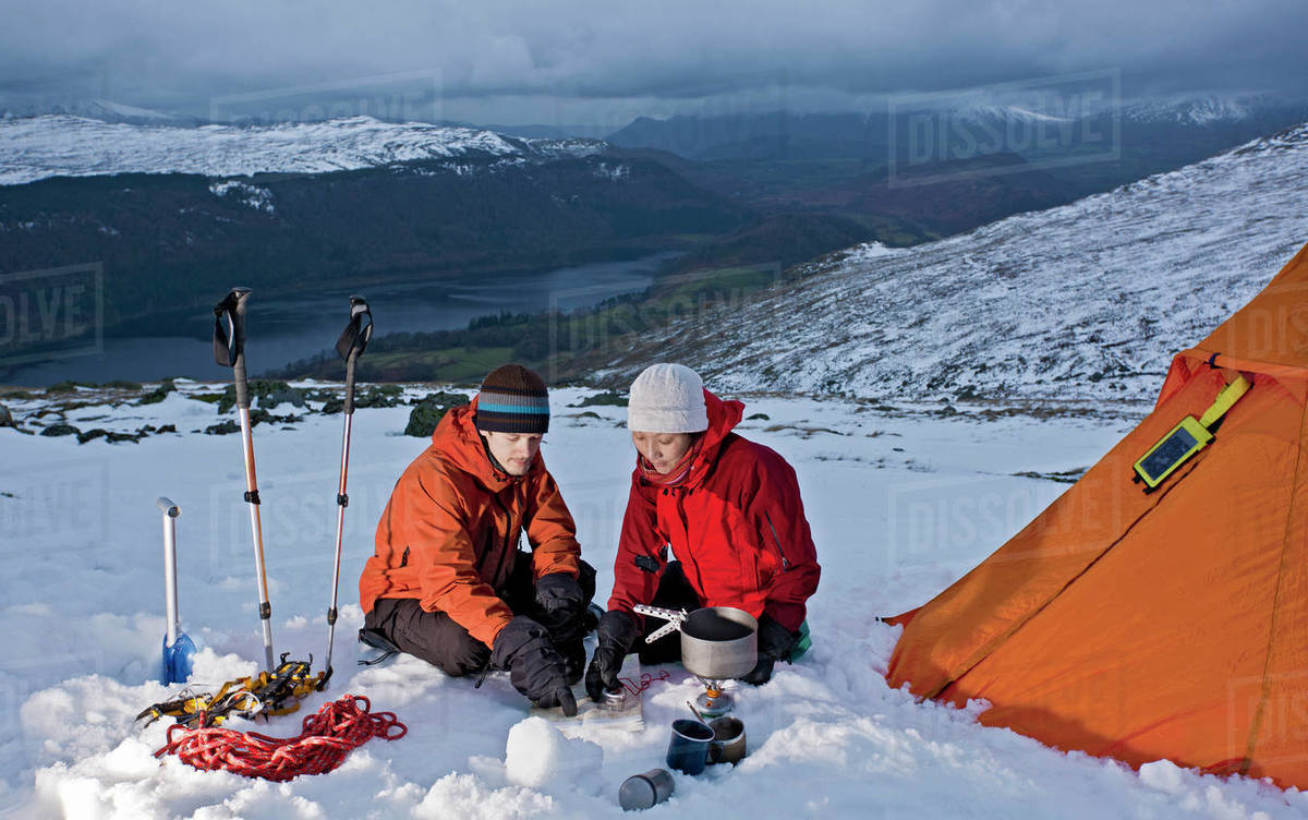 Couple reading map on the side of Helvellyn mountain Royalty-free stock photo