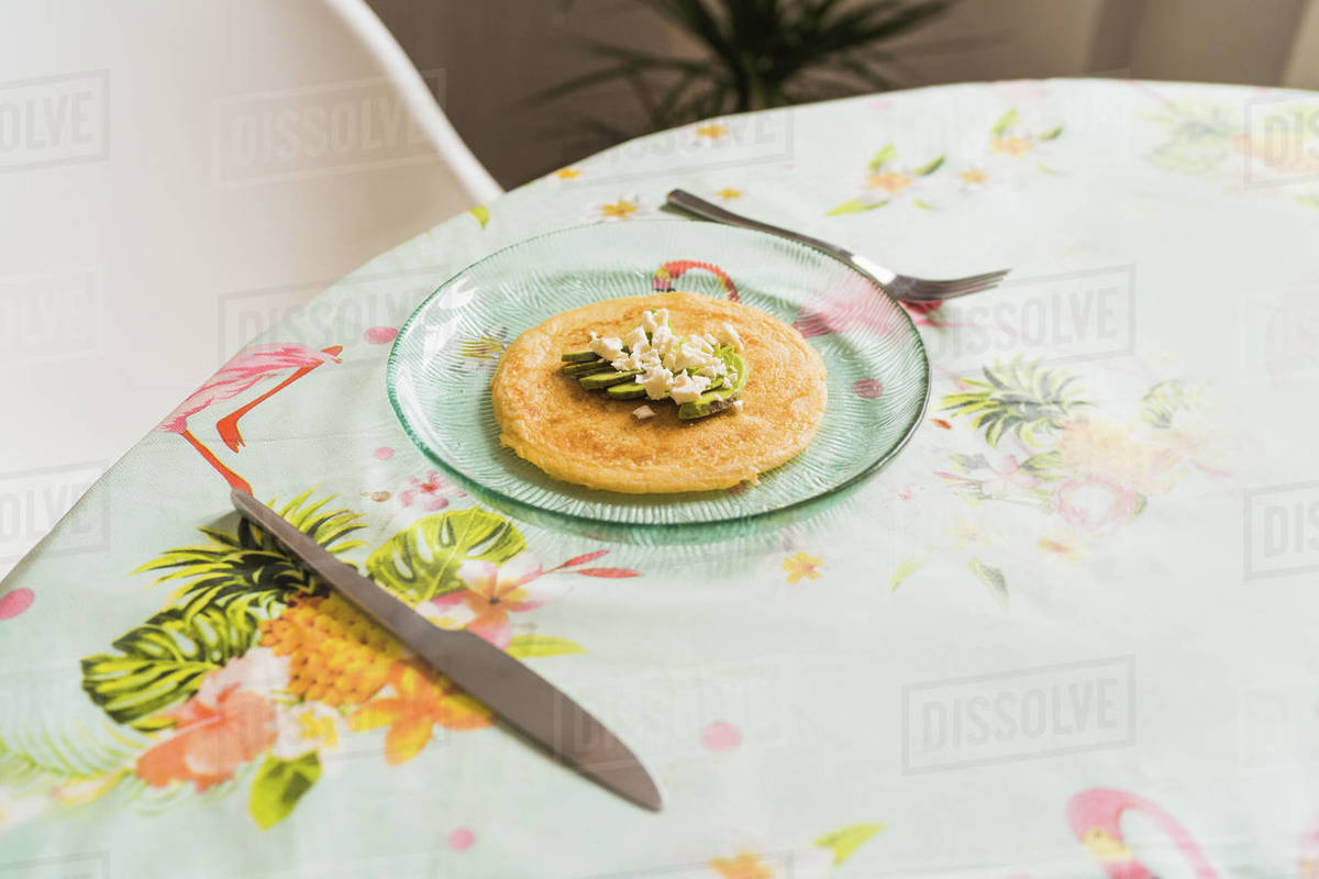 A plate of pancakes with cheese and avocado is on the table Royalty-free stock photo