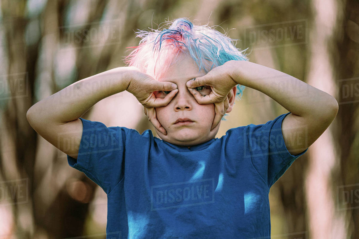 Young boy making upside down hand glasses Royalty-free stock photo