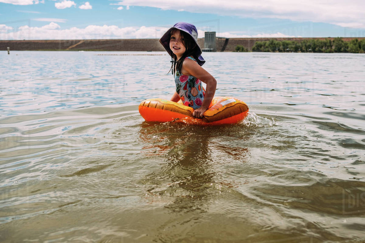 Young girl playing in lake alone Royalty-free stock photo