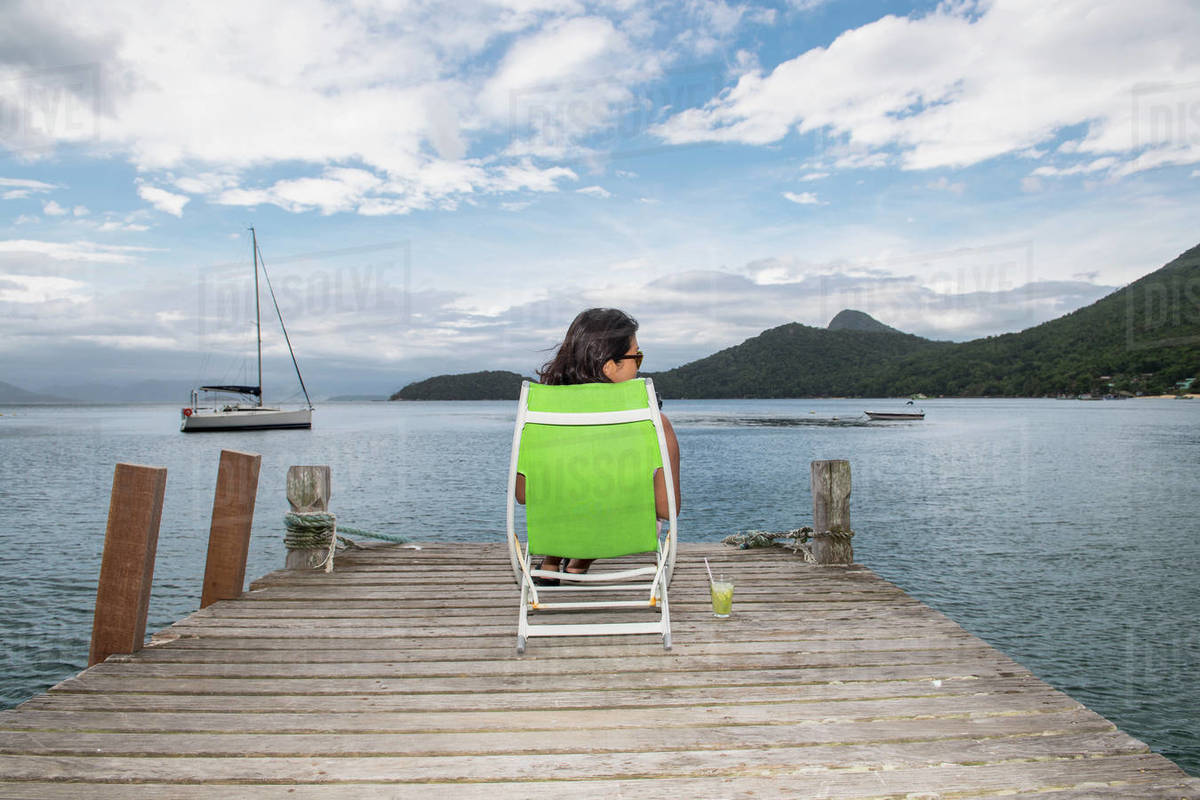 Woman relaxing on pier on the tropical island of Ilha Grande Royalty-free stock photo
