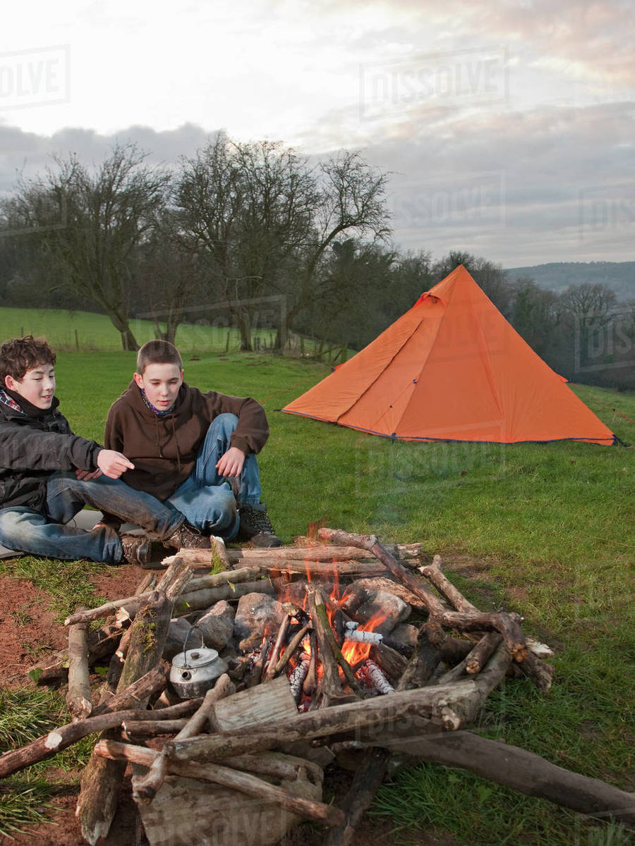Two boys sitting at campfire in South Wales Royalty-free stock photo
