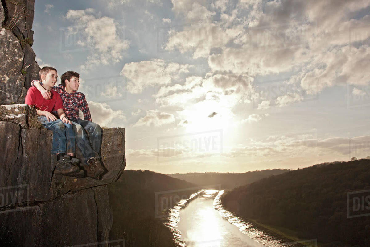 Two friends sitting on a ledge Royalty-free stock photo