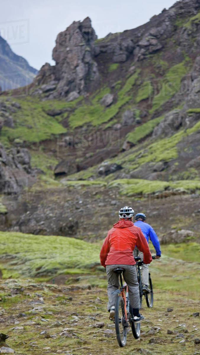 Two friends riding their mountain bikes around Lake Thingvellir Royalty-free stock photo
