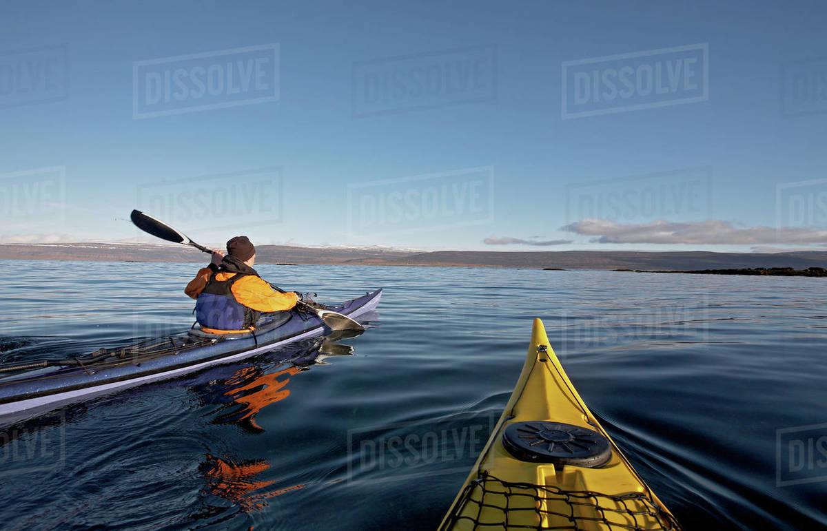 Two sea kayaks navigating through still lake on the Icelandic highland Royalty-free stock photo