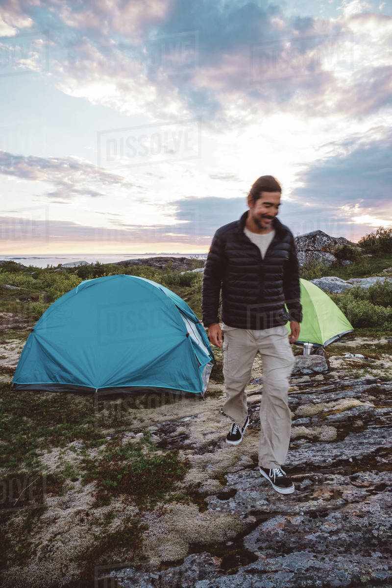 Man walking in a campsite smiling Royalty-free stock photo