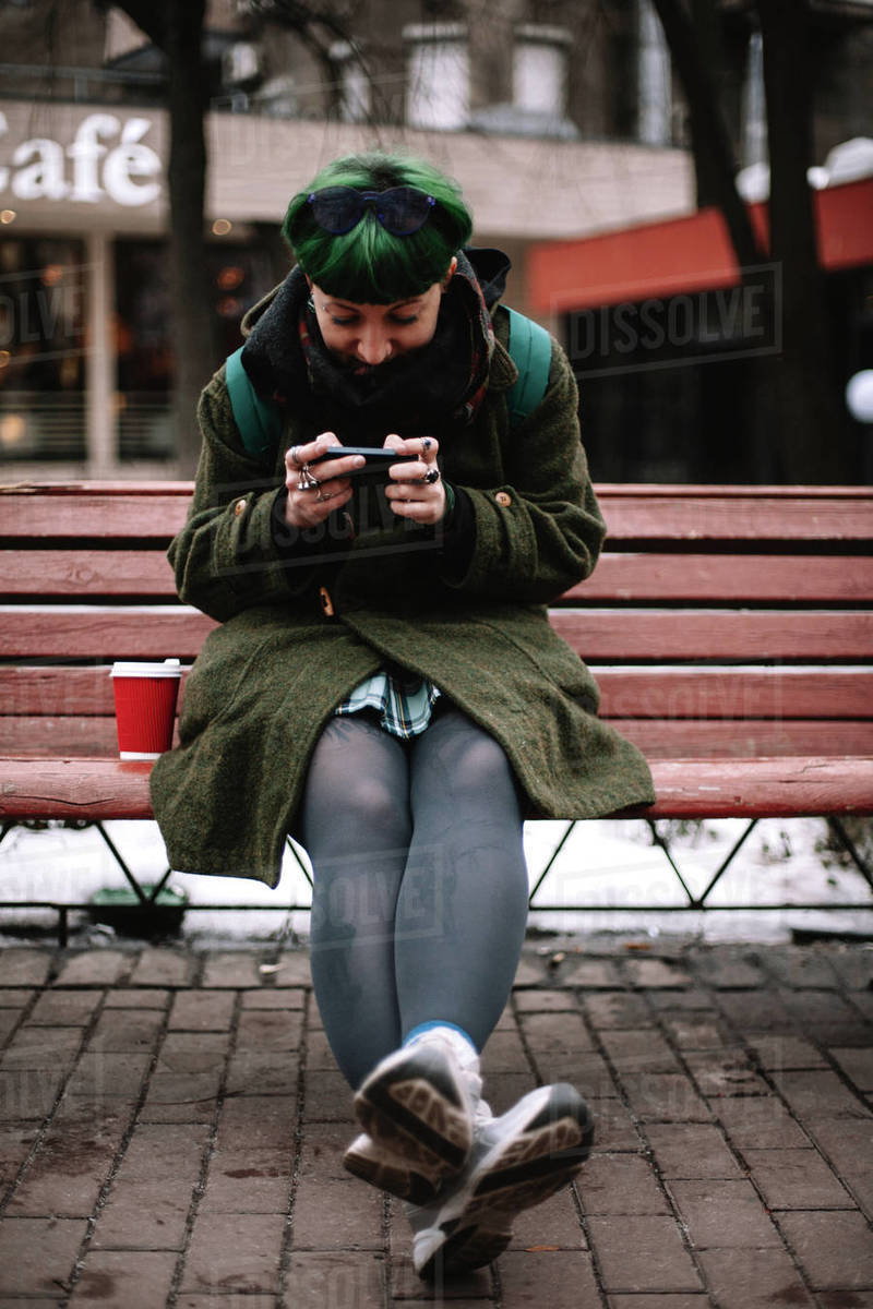 Portrait of happy non-binary hipster using smart phone in city Royalty-free stock photo