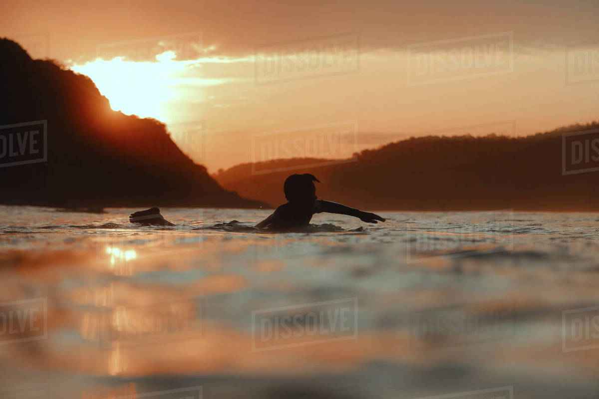 Surfer in sea at sunset,Lombok, Indonesia Royalty-free stock photo