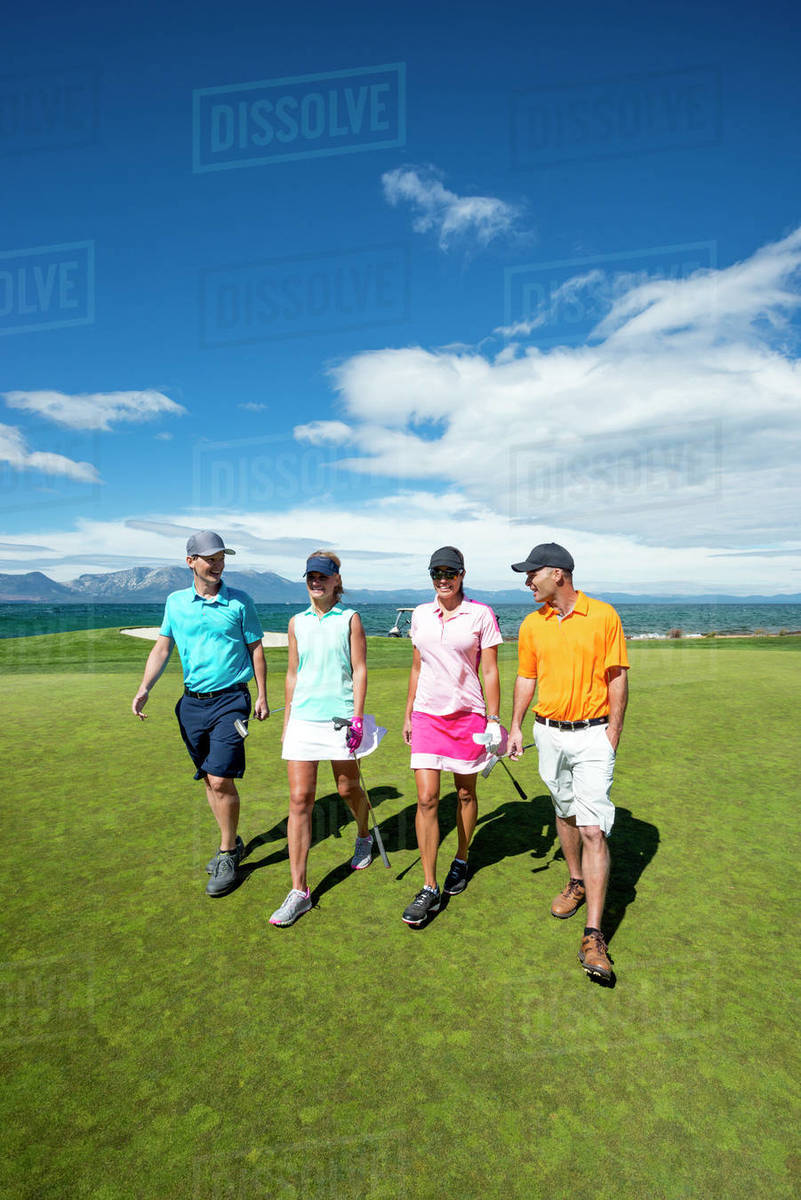 Friends playing golf at Edgewood Tahoe in Stateline, Nevada. Royalty-free stock photo