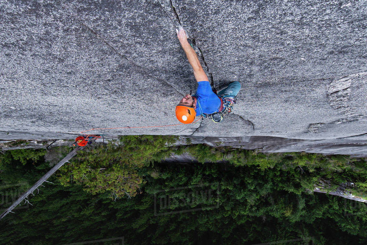 Man crack rock climbing in Squamish view from top exposed multipitch Royalty-free stock photo