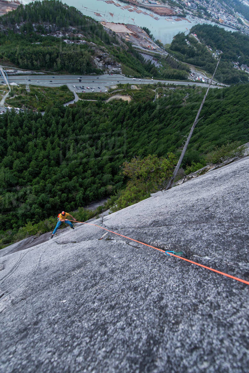 Man rock climbing and swinging around with exposed view Squamish Chief Royalty-free stock photo