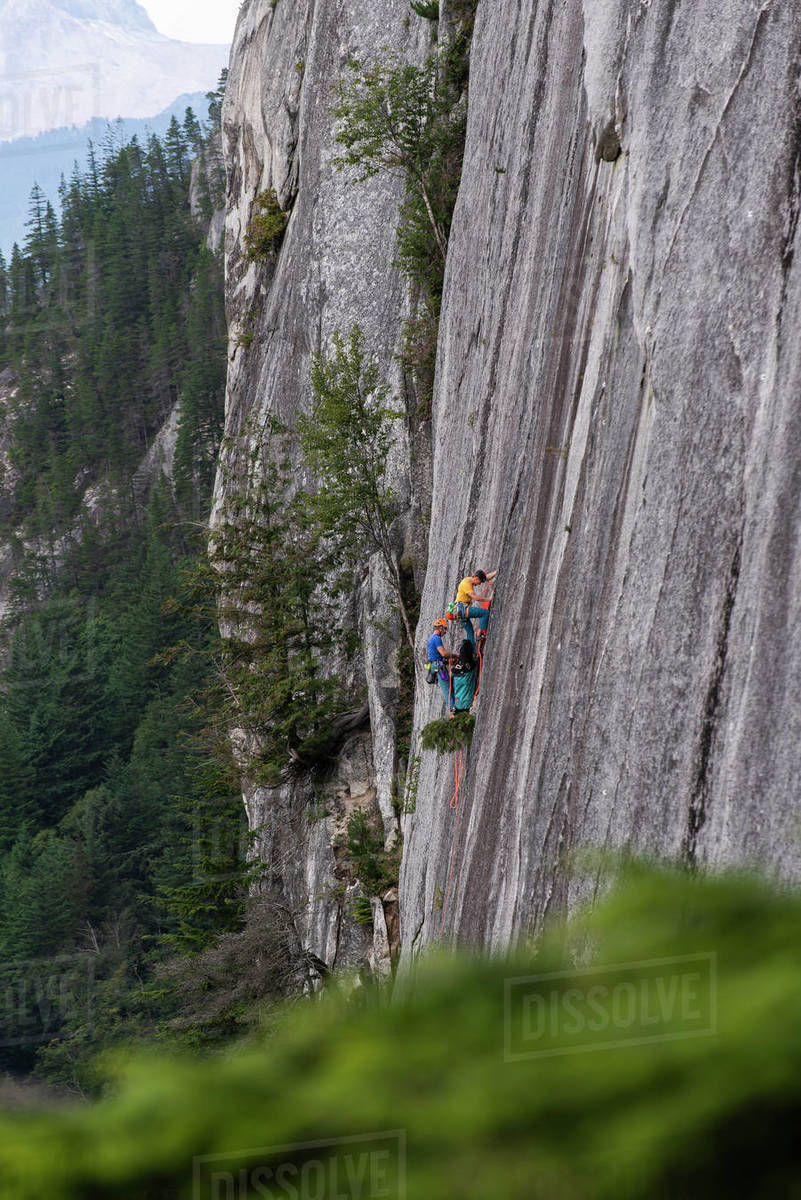 Two men big wall climbing on the Chief Squamish with haul bag Royalty-free stock photo