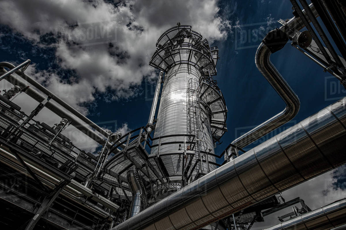 Natural gas plant structures against dark blue sky Royalty-free stock photo