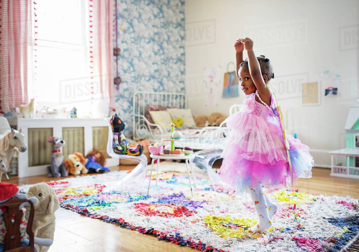 Full length of girl in fairy costume dancing at home Royalty-free stock photo