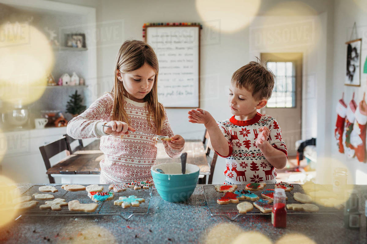 Boy and girl siblings decorating Christmas cookies Royalty-free stock photo