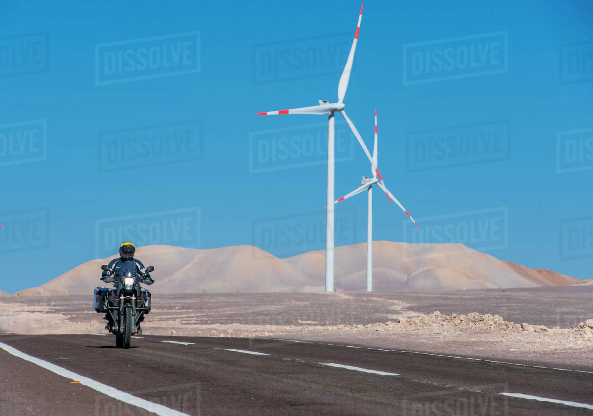 Man riding his ADV motorbike at wind farm in the remote Atacama desert Royalty-free stock photo