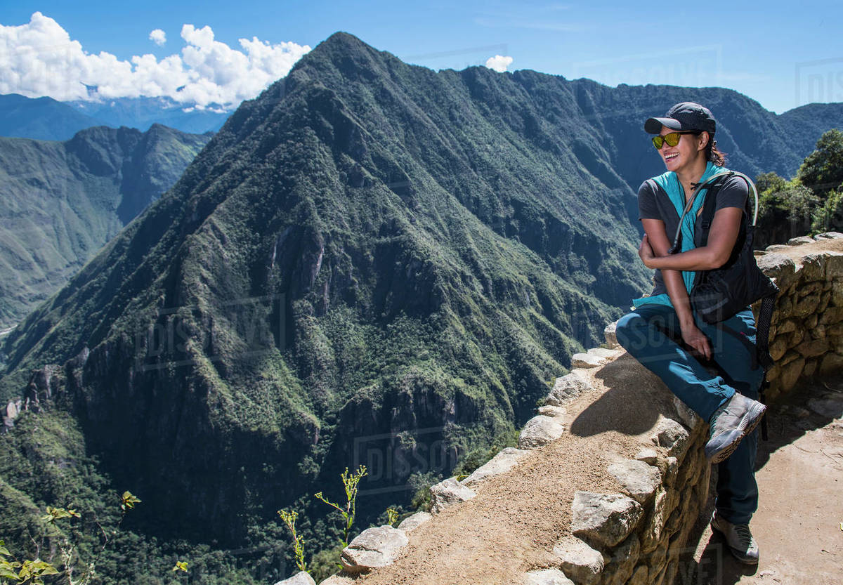 Woman resting on drywall on the Inca Trail close to Machu Picchu Royalty-free stock photo
