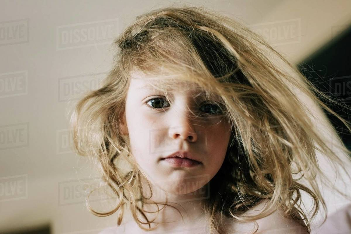 Candid portrait of young girl with bed head hair in the morning Royalty-free stock photo