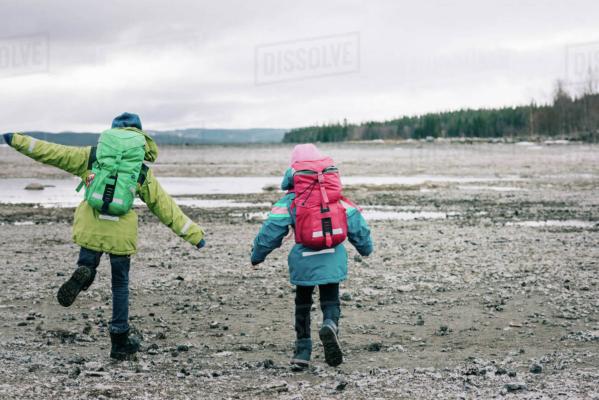 Siblings hiking together by the water in northern Sweden Royalty-free stock photo