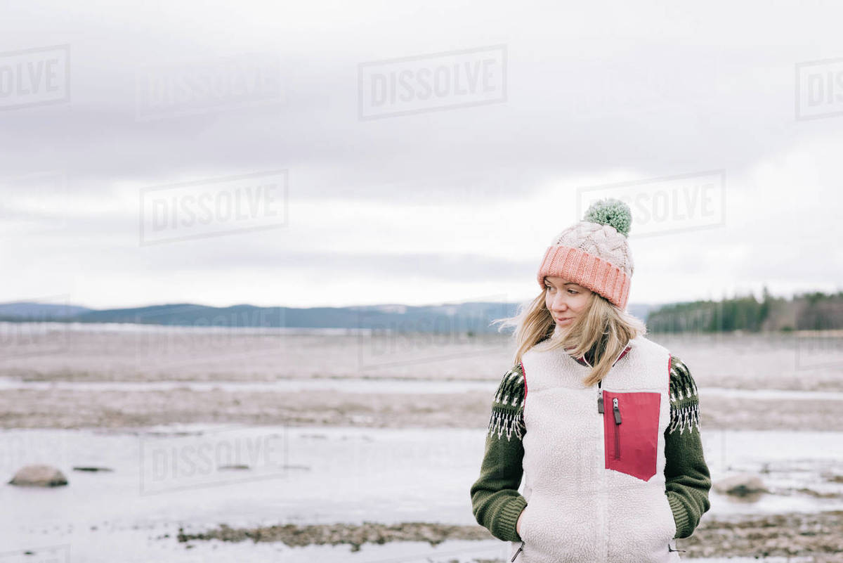 Portrait of woman standing alone in the great outdoors in Sweden Royalty-free stock photo