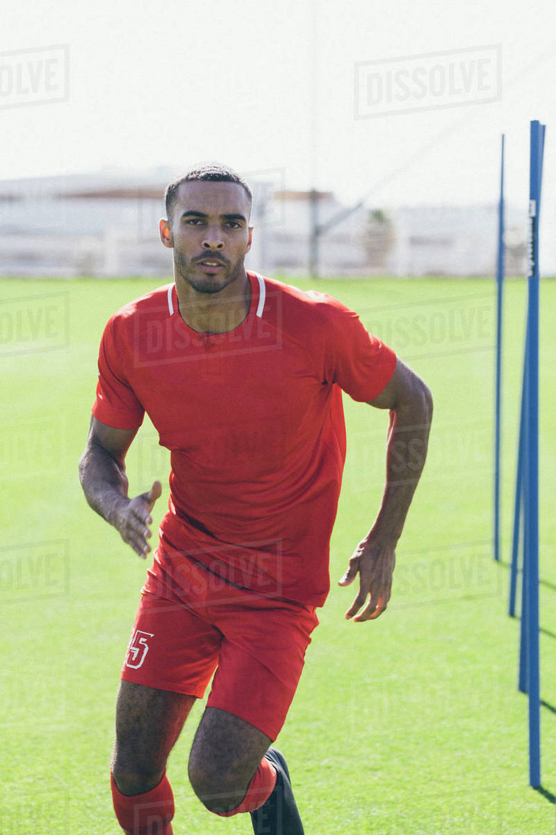 Upper part of male African American soccer player practicing at pitch Royalty-free stock photo