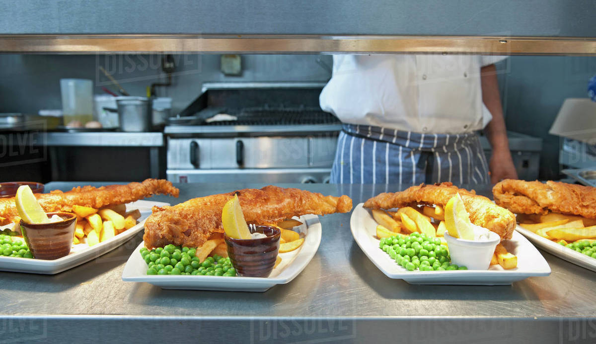 Fish and chips prepared at commercial kitchen in the UK Royalty-free stock photo