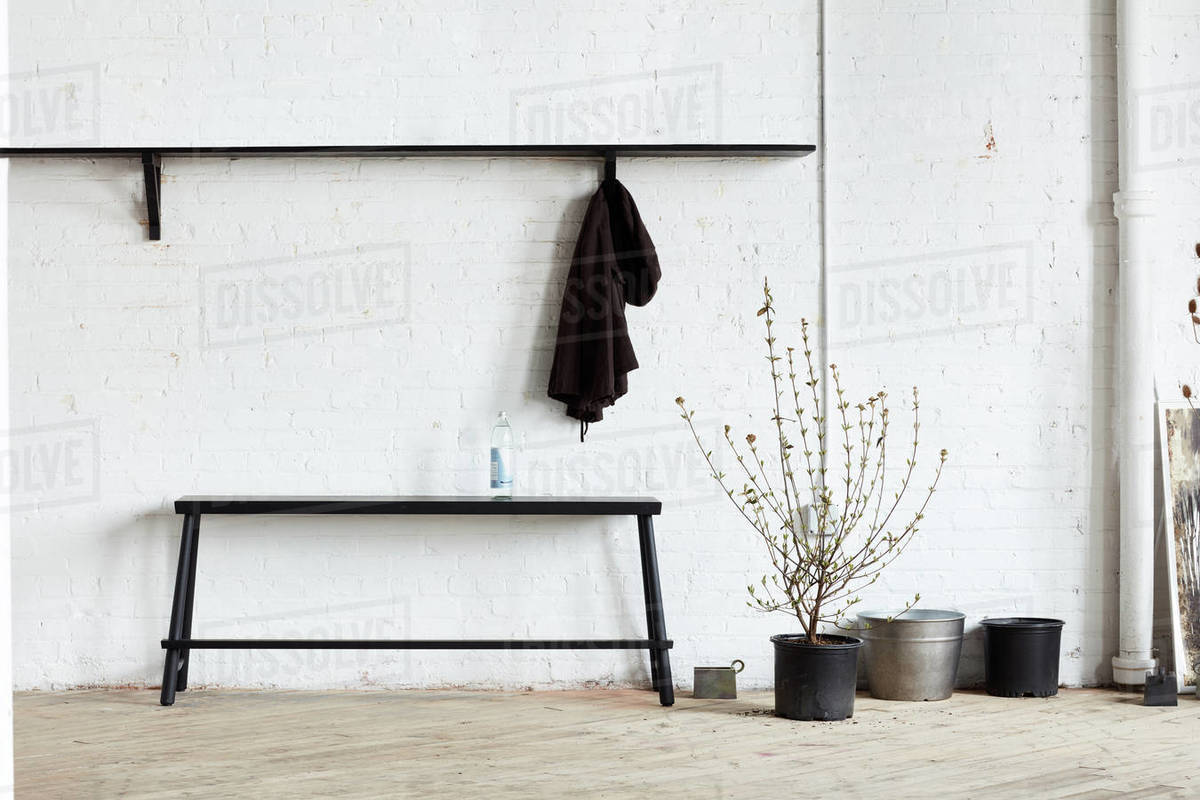 Bench, shelf, coatrack in industrial space Royalty-free stock photo