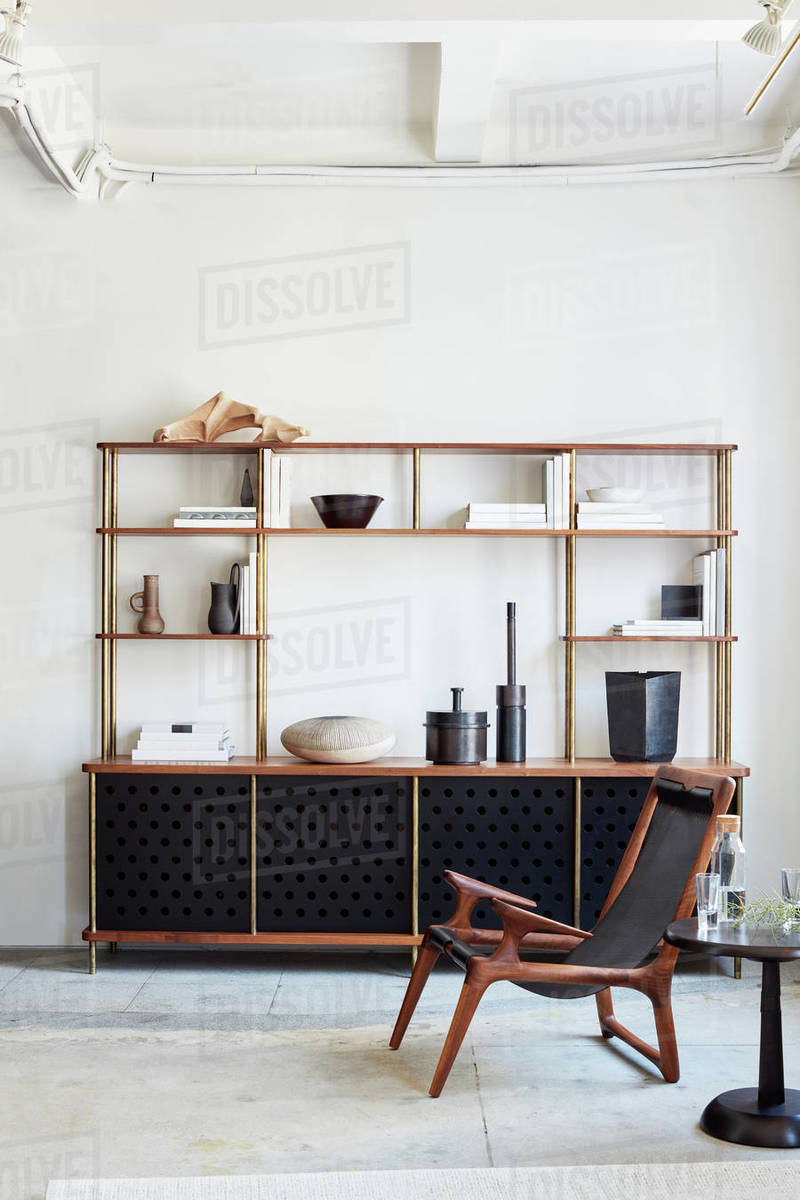 Modern, wood and metal Livingroom console with chair and table Royalty-free stock photo