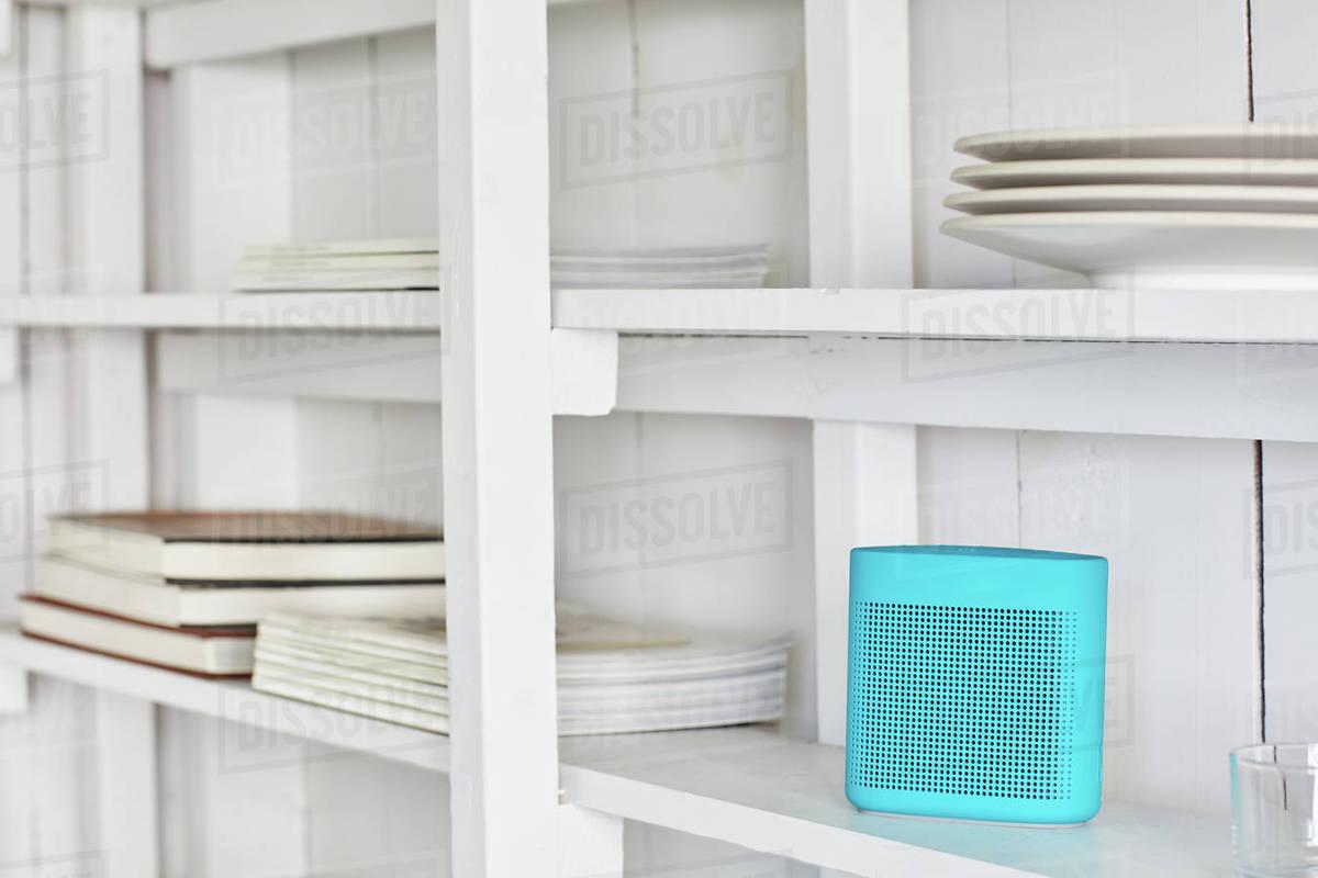 Bluetooth speaker on cabin shelf Royalty-free stock photo