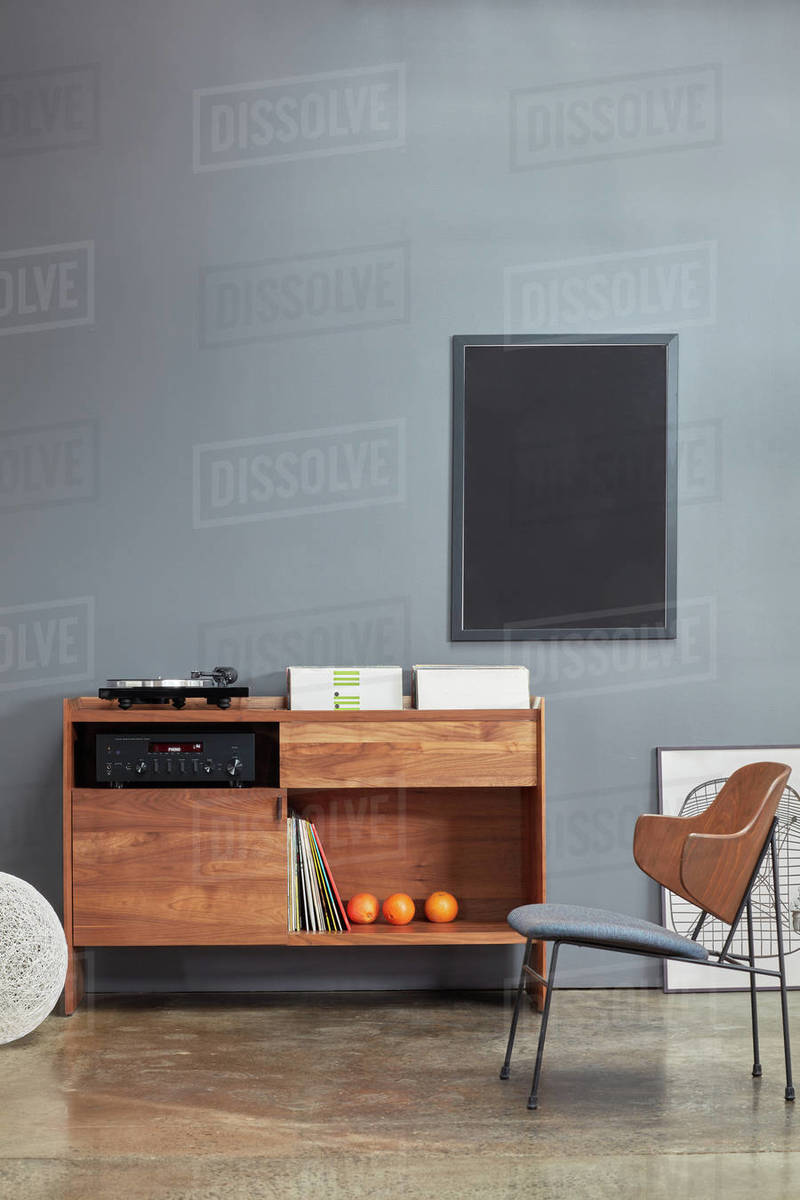 Vignette of custom stereo cabinet, vinyl records and chair Royalty-free stock photo
