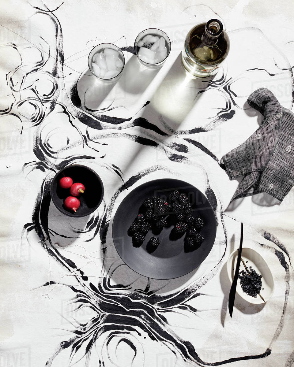 Still life on painted backdrop with fruits, glass and pottery Royalty-free stock photo