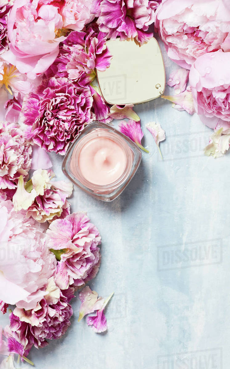 Handcream with roses on textured surface Royalty-free stock photo