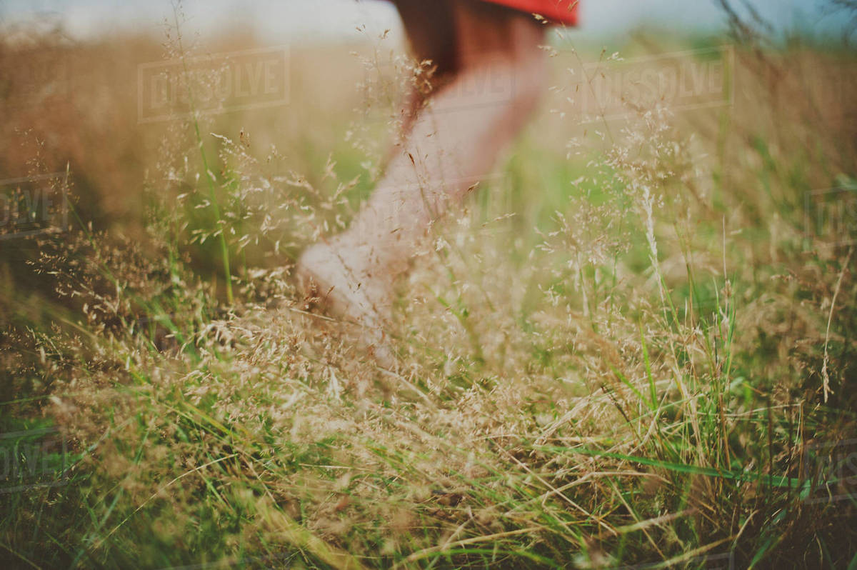 Low section of girl walking on field Royalty-free stock photo