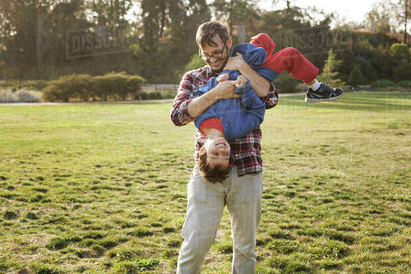 Father playing with son (4-5), Royalty-free stock photo