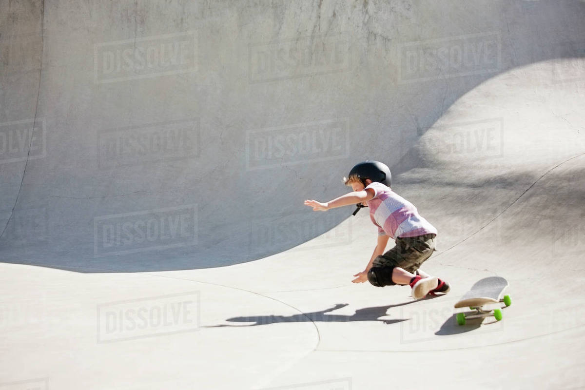 Skate Board Ramp >> Boy Falling On Skateboard Ramp Stock Photo Dissolve