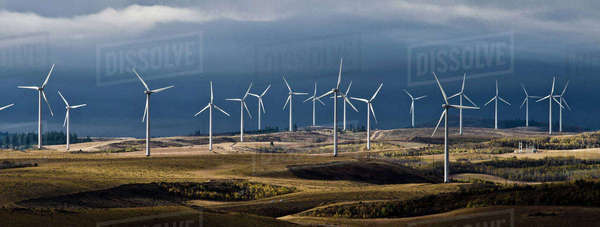 Windmills on landscape against cloudy sky Royalty-free stock photo
