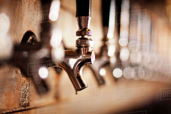 Close-up of metallic beer taps at bar Royalty-free stock photo