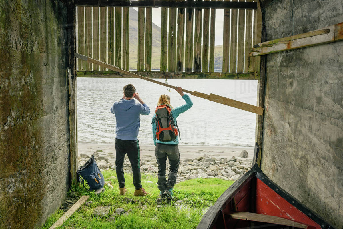 Unrecognizable couple in boat shed Royalty-free stock photo