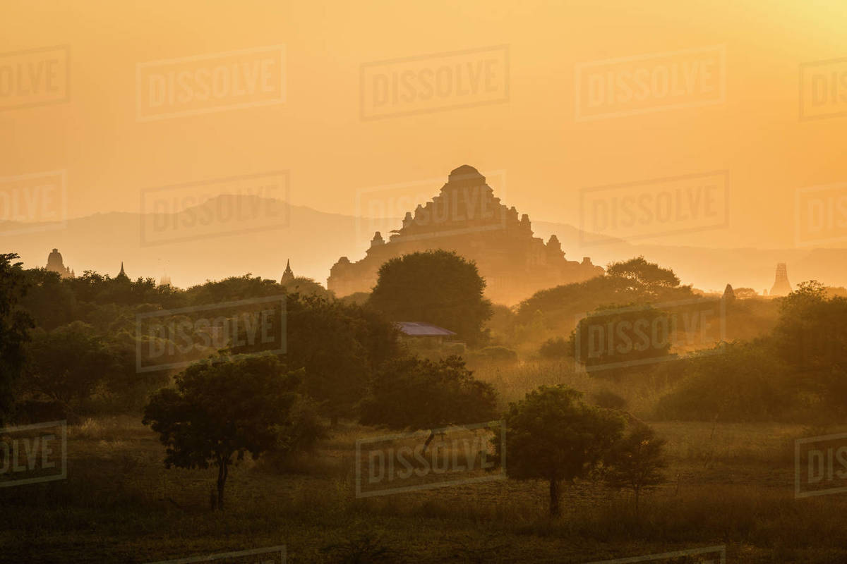 Dhammayangyi Temple against clear orange sky during sunset, UNESCO, Bagan, Myanmar Royalty-free stock photo