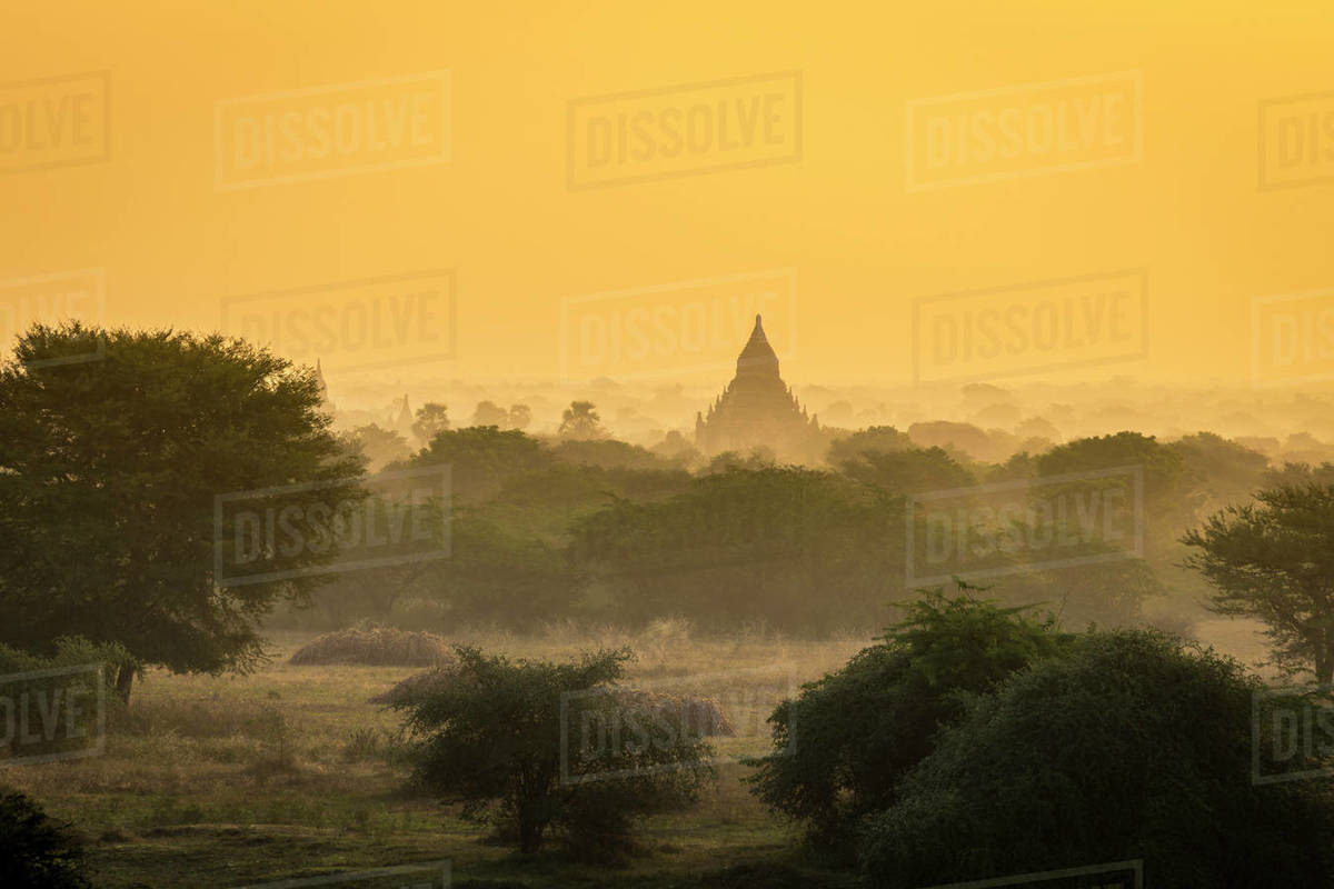 Pagoda against clear orange sky during sunrise, UNESCO, Bagan, Myanmar Royalty-free stock photo