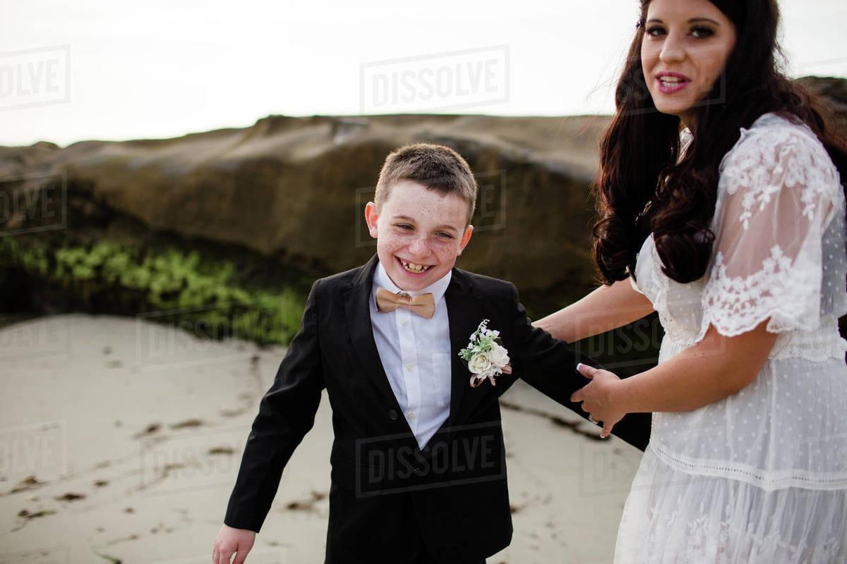 Mom Tickling Son on Windansea Beach in San Diego Royalty-free stock photo