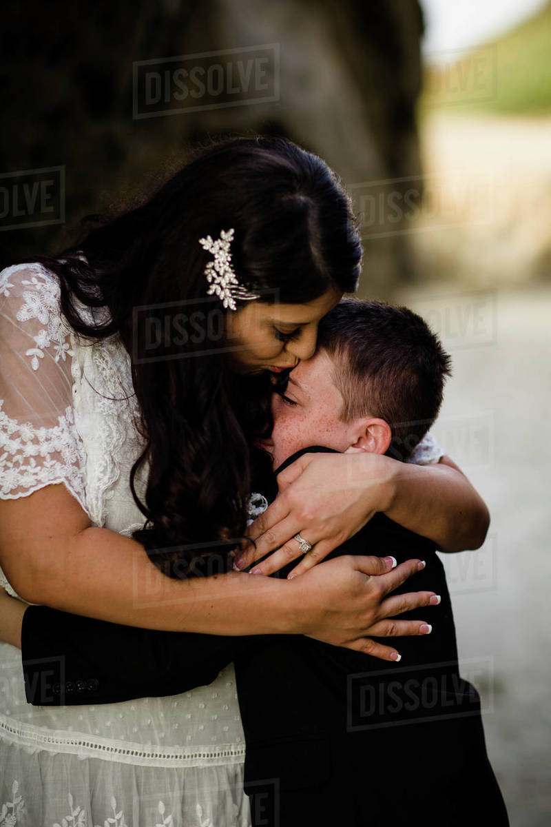 Mother & Son Embracing on Beach in San Diego Royalty-free stock photo