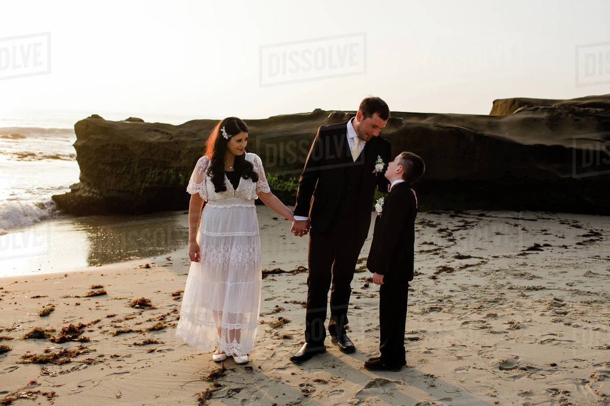 Newlyweds & Son on Beach at Sunset in San Diego Royalty-free stock photo