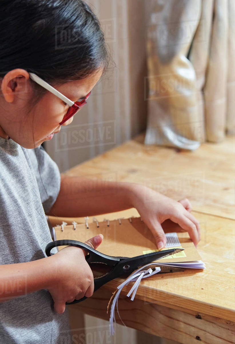 A girl trimming the hand craft book Royalty-free stock photo