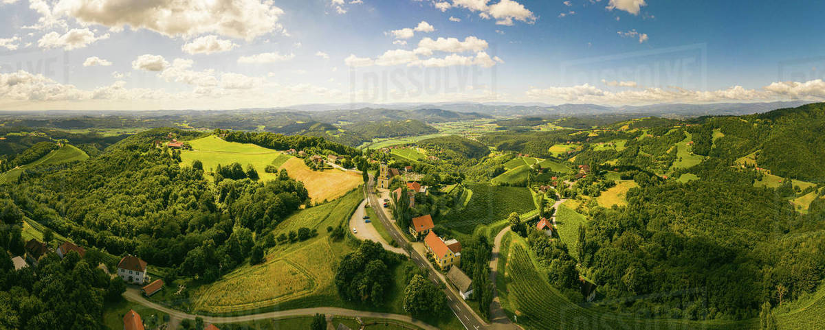 Aerial panorama of of green hills and vineyards with mountains in background. Austria vineyards landscape in Kitzeck im Sausal Royalty-free stock photo