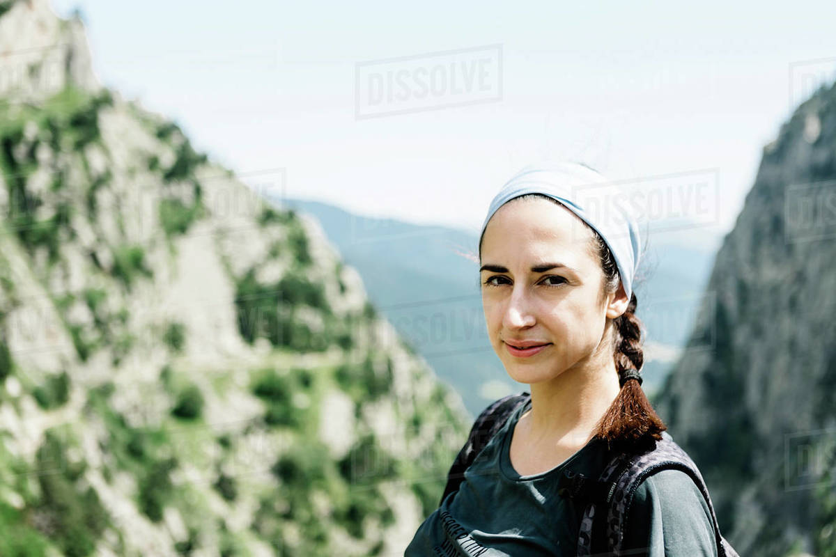 Portrait of an adventure woman against a landscaped background Royalty-free stock photo