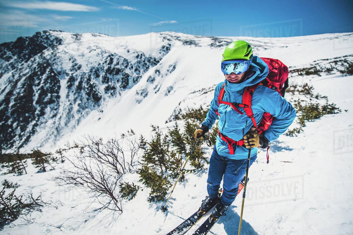 Man skier standing atop Tuckerman Ravine in New Hampshire Royalty-free stock photo