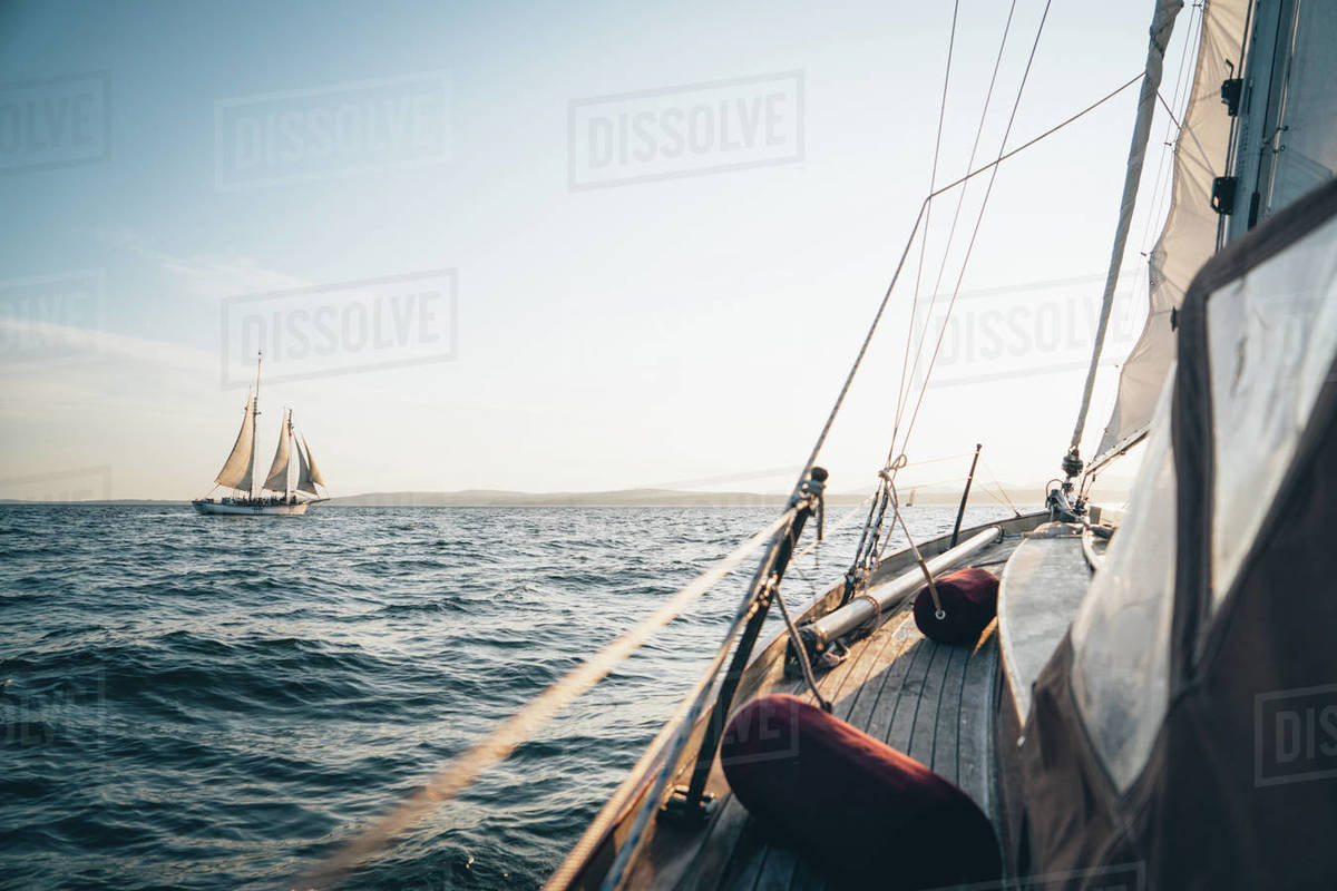 A schooner in Maine Bay viewed from another sailboat during late day Royalty-free stock photo
